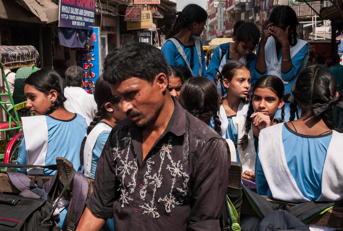 Girls on a rickshaw to school in Dehli